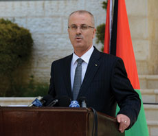 Palestinian Prime Minister Rami Hamdallah answers  reporter's questions at a news conference after the first cabinet meeting of the Palestinian unity government in Ramallah, West Bank. (UPI/Debbie Hill)