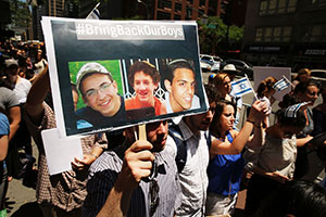 New Yorkers gather in front of the Israeli Consulate for a vigil for the three missing teens. (Spencer Platt/Getty Images)