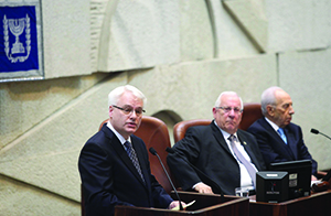Reuven Rivlin (center), then Knesset speaker, sits next to his predecessor Shimon Peres during a speech by Croatian President Ivo Josipovic. (File photo)
