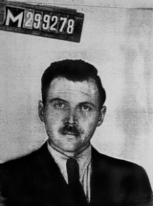 A 1956 photo taken by a police photographer in Buenos Aires for Josef Mengele's Argentine identification document.  (Wikimedia Commons)