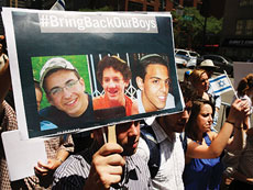 People gather for a vigil for the three Israeli teens outside the  Israeli Consulate on June 16.