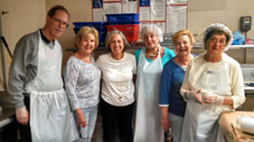 David Slotnick, Phyllis Freiman, Geri Minkin, Norma Fedder, Shelly Baernstein and Dena Gerber take a break after packaging kosher meat meals for delivery. (Provided)