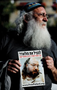 An Israeli right-wing demonstrstor holds  a picture of Jonathan Pollard, a Jewish  American who was jailed for life in 1987 on charges of spying  on the United States, during a 2008  demonstration in Israel. (JOE KLAMAR/AFP/Getty Images/Newscom)