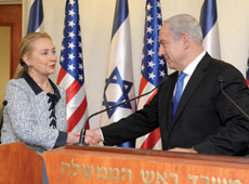 "Then Secretary of State Hillary Clinton, shown here meeting with Israeli Prime Minister Benjamin Netanyahu in Jerusalem, reveals in her book ""Hard Choices"" that Rahm Emanuel, former White House chief of staff, pushed hard for Israel to stop building settlements in the West Bank as a condition for starting peace talks with the Palestinians. (File photo)"