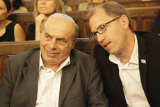 Jewish Agency Chairman  Natan Sharansky (left) joins  the organization's head of  French operations, Ariel Kandel, at a Paris synagogue on July 2. (Alain Azria)