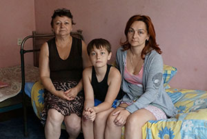Ludmila Lazaurenko (right), son Anatoly and mother Nadezhda  Belovol live in temporary housing near Dnepropetrovsk, Ukraine. (Photos Cnaan Liphshiz)