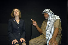 "Mary Jane Oelke as Madeleine Albright and Percy W. Thomas as Yasser Arafat deliver a heated exchange in ""Fourteen Days in July,"" a dramatization of tense negotiations during the Camp David Israeli-Palestinian peace talks of 2000, based on the memoir of Ambassador Dennis Ross, ""The Missing Peace."" (Marc Apter)"