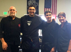 Nadav Korman (middle left) and Andy Sokal (middle right) pose with their  instructor, Jennifer Lake, and Lake's  father, the founder of CSA, Douglas Lake, after receiving their black belts. Below: Sokal and Korman test for their black belts at he Owings Mills JCC. (Photos Provided)