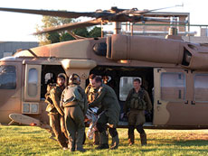 IDF soldiers rush injured Israelis to Soroka Hospital in Beersheba after evacuating them by helicopter on Aug. 26 following a mortar attack on Kibbutz Nirim near the Gaza border. The incident took place shortly before the latest  Israel-Hamas cease-fire went into effect.