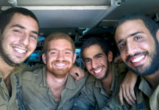 Ron Gordon (left), who joined the Israel Defense Forces after growing up abroad, says lone soldiers act as surrogate family for each other after they leave the battlefield. (Courtesy Ron Gordon)