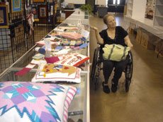 Ellen Federoff with her 19 needlepoint works that won awards at this year's Maryland State Fair.  (Provided)