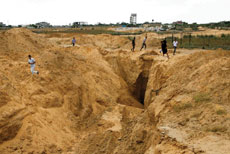 Palestinians view what used to be a tunnel leading from the Gaza Strip into Israel in the Rafah area of southern Gaza.  Abed Rahim Khatib/Flash90