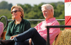 Hillary and Bill Clinton share a laugh during an Iowa event benefiting the campaign of Democratic Sen. Tom Harkin. (Karen Murphy)