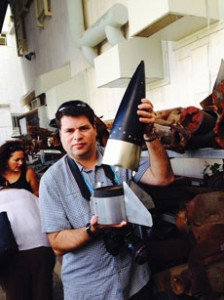 Participant Michael Greenbaum displays rocket scraps from the Iron Dome missile defense system.
