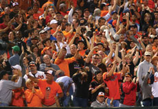 Orioles fans celebrate before the last out against the Toronto Blue Jays at Oriole Park at Camden Yards on Sept. 16. The O's clinched the American League East that night with a 8-2 victory. (Tony Quinn/Icon Sportswire 255/Tony Quinn/Icon Sportswire/Newscom)