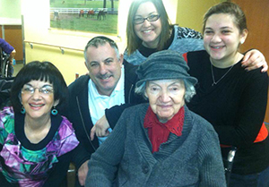 Ida Goldberg (center) sits with her granddaughter, grandson-in-law and two of her great-grandchildren. (Provided)