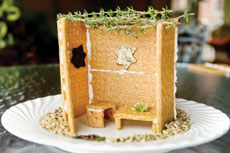 Making the holiday  cooking experience even more fun, Ilene Spector and her grandson made this memorable — and tasty — edible sukkah. (David Stuck)