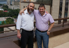 Zelig Brez (left), director of the Dnepropetrovsk Jewish community proudly stands atop the 22-story Menorah Center with a community board member. (Cnaan Liphshiz)