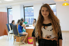 Student Nastya Moscalenko attends a class at the Menorah Center, which also includes medical clinics, shops and a bank. (Cnaan Liphshiz)
