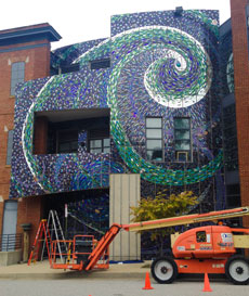 The American Visionary Art Museum's western wall, which faces Federal Hill, displays a rendering of the aurora borealis.