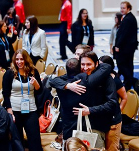 Millennials greet each other at the 2014 GA, where there was much discussion about how to keep young Jews engaged in the community. Photo by David Stuck
