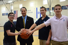 Former Israeli basketball star Tal Brody, who spoke with students at both Krieger Schechter Day School (above, right) and Beth Tfiloh Dahan Community School, took time out for photos with BT students (from left) Yitzy Teichman, Michael Millstein and Yair Pincever (above) and with KSDS students (from left) Noah Abrams,  Gabe Lichtenstein, Acey Vogelstein and Sage Friedman. (Melissa Gerr)