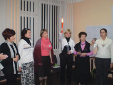 Irina Skliankina (center with candle) leads a  Jewish women's group  in a Havdalah service.