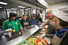 Volunteers serve hot lunches at Baltimore nonprofit Paul's Place, where more than 70,000 meals were served during 2014.