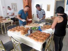 Volunteers in a soup kitchen pack lunches for poor schoolchildren in Eilat.