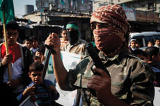 Palestinians in the Gaza Strip celebrate a deadly attack on a Jerusalem  synagogue in November. Israel's elections in March are expected to  have a much greater focus on security than they did two years ago.