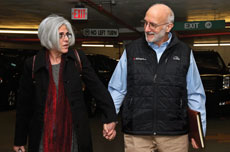 Recently reunited Alan and Judy Gross walk through a Washington, D.C., parking lot Wednesday on their way to a press conference. (KEVIN LAMARQUE/REUTERS/Newscom)