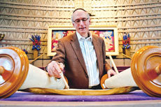 BHC Cantor Robbie Solomon reads from the  congregation's 250-year-old Holocaust Torah scroll. (David Stuck)
