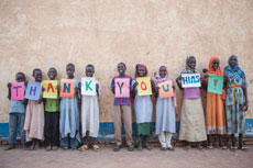 "Happy refugees at Farchana in Chad spell out ""Thank You HIAS!""  (Photo by Glenna Gordon/HIAS)"