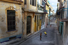Children playing baseball in the streets of Havana is a common sight.