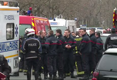 Police officers responding to the deadly shooting at the Paris headquarters of the Charlie Hebdo satirical newspaper, Jan. 7, 2015. (YouTube)