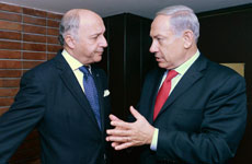 "French Foreign Minister Laurent Fabius (left) meets with Israeli Prime Minister Benjamin Netanyahu during a visit to Israel in November 2013. Fabius has said France does not want ""a symbolic recognition of a virtual state"" of Palestine. (Kobi Gideon/GPO/FLASH90)"
