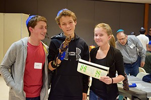 Sam Seliger, Eli Kuperman and Amelia Oliver present their finished prosthetic hand. (Provided)