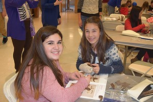 Hannah Treger (left) and Isabella Kushner work on completing another one. (Provided)