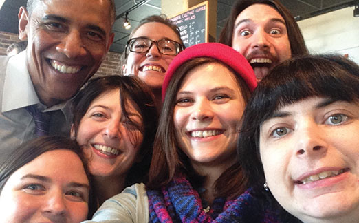 President Barack Obama poses for a selfie with the staff at Charmington's in Baltimore City. The cafe and coffee shop's managing partner spoke with the president about paid sick leave and family leave. (Provided)