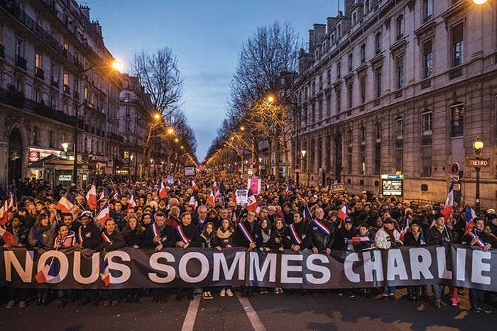 "Demonstrators carrying a sign reading ""We Are Charlie"" march in a Paris square during a unity rally following the terrorist attacks in the French capital. (Dan Kitwood/Getty Images)"
