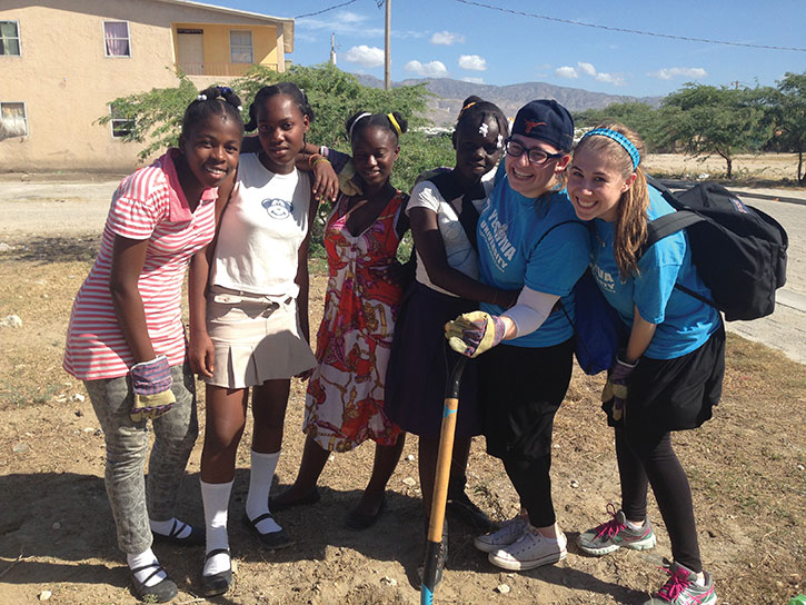 Eliana Shields (second from right) planted trees with students at a school in rural Haiti as part of a service trip through Yeshiva University.
