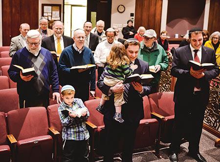 Congregants at Beth Tfiloh Congregation take part in a Havdalah service. (David Stuck)