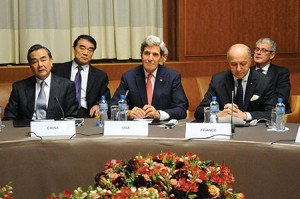 Secretary of State John Kerry is flanked by Foreign Minister Wang Yi of China and Foreign Minister Laurent Fabius of France at U.N. headquarters in Geneva following nuclear talks with Iran in November 2013. Some U.S. lawmakers fear that a focus on fighting ISIS will distract from preventing a nuclear Iran. (Wikimedia Commons)