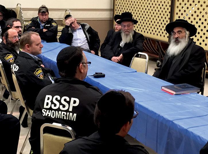 The Dushinsky Rebbe, Rabbi Yosef Tzvi Dushinsky, addresses Shomrim members in December 2014. (Photo David Stuck)