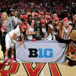 The Maryland women's basketball team poses with their coaches, UMD President Wallace D. Loh and school mascot Testudo in front of the Big Ten Conference trophy. ( Maryland Athletics)