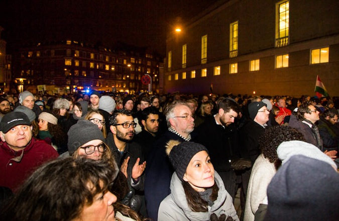 Thousands attend a solidarity march at Copenhagen's Great Synagogue following the slaying of a Jewish volunteer guard outside the building early Sunday morning. (Sille Arendt)