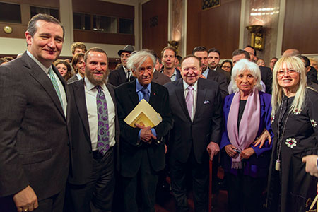 Panel host Rabbi Shmuley Boteach (second from left) stands between  featured guests Sen. Ted Cruz (left) and Elie Wiesel.