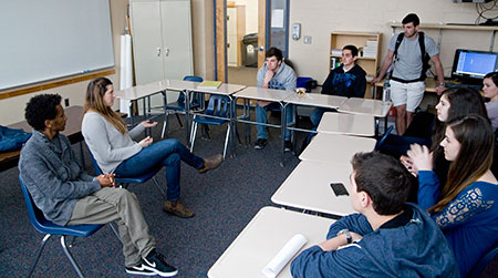 Yehuda (left) and Gal, both former IDF soldiers, take questions from Park School students after giving presentations about their lives in Israel at an  assembly.
