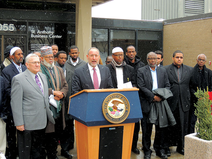 Andrew Luger (at podium), U.S. Attorney for the District of Minnesota, leads his state's initiative to combat terrorist recruitment that targets the Somali community. (Provided)