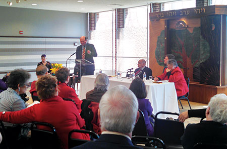Rabbi Andrew Busch addresses the room at the 55th annual Interfaith Institute. (Heather Norris)